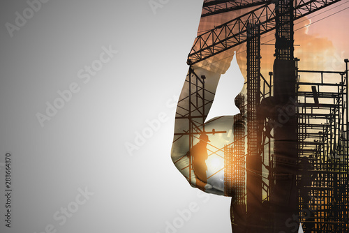 Double exposure concept with engineer or foreman on construction site of background,copy space for text.