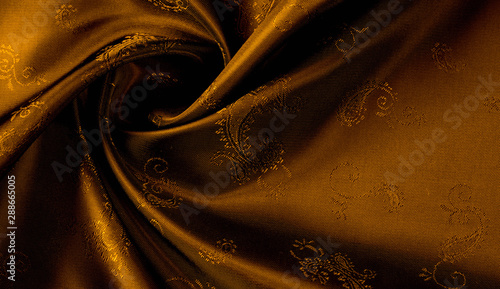 Texture background pattern Yellow mustard brown chiffon fabric with paisley print High quality pure silk chiffon fabric bright beautiful color combinations This fabric is suitable for design wallpaper