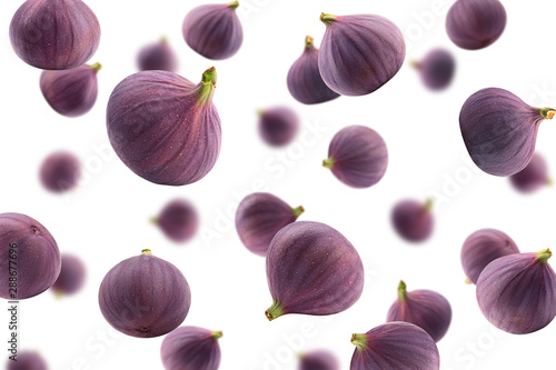 Falling fig isolated on white background, selective focus - 288677696
