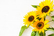 canvas print picture - Autumn background with a bouquet of yellow sunflowers against a white brick wall.