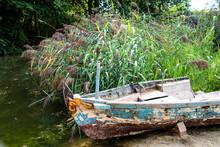 Old Abandoned Wrecked Fishing Boat At A Lake