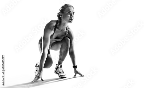 Fototapeta Sports background. Runner on the start. Black and white image isolated on white. obraz