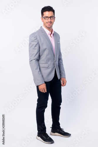 Full body shot of young handsome businessman with eyeglasses - 288682611