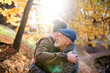 canvas print picture Senior father and his son on walk in nature, hugging.