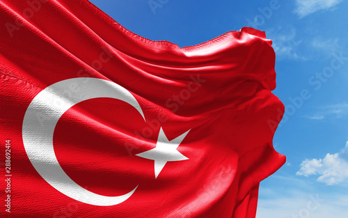 Valokuva  Turkish Flag is Waving Against Blue Sky with Clouds