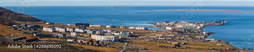 In de dag Mediterraans Europa Panorama of the polar port town of Pevek. Pevek is the northernmost city in Russia. The coast of the East Siberian Sea of the Arctic Ocean. Chukotka, Polar Siberia, Russian Far East. Russian Arctic.