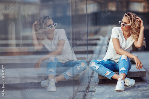 Fashion portrait of a young woman with white sunglasses Wallpaper Mural