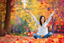 Happy Woman Enjoying Life In The Autumn