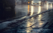 Hard Rain Fall In The City With Blurry Cars .Selective Focus.