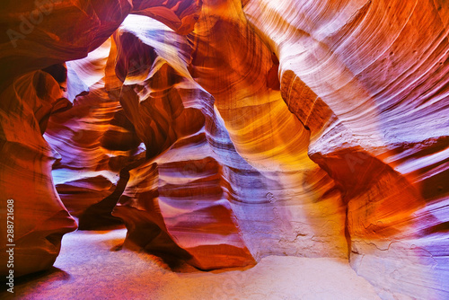 View of Upper Antelope Canyon with sunbeam shined into canyon at noon in early October in Arizona, USA.