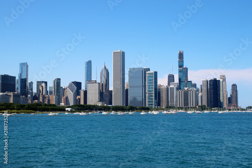 Chicago downtown skyline with Michigan lake.Scenic summer cityscape with lakefront skyscrapers of Chicago with drifting yachts on the Michigan lake harbor. American urban city architecture background.
