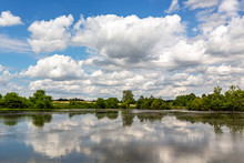 Clouds Reflected In A Lake At ...