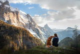 Fototapeta  - girl with a dog in the mountains. Autumn mood. Traveling with a pet. Nova Scotia Duck Tolling Retriever