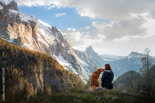 girl with a dog in the mountains Canvas Print