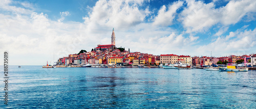 Foto auf Leinwand Blau Stunning spring cityscape of Rovinj town, Croatian fishing port on the west coast of the Istrian peninsula. Bright morning seascape of Adriatic Sea. Traveling concept background.