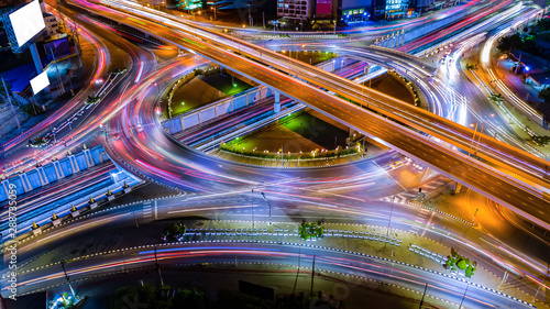 Stampa su Tela Aerial view Expressway motorway highway circus intersection at Night time Top view , Road traffic in city at thailand