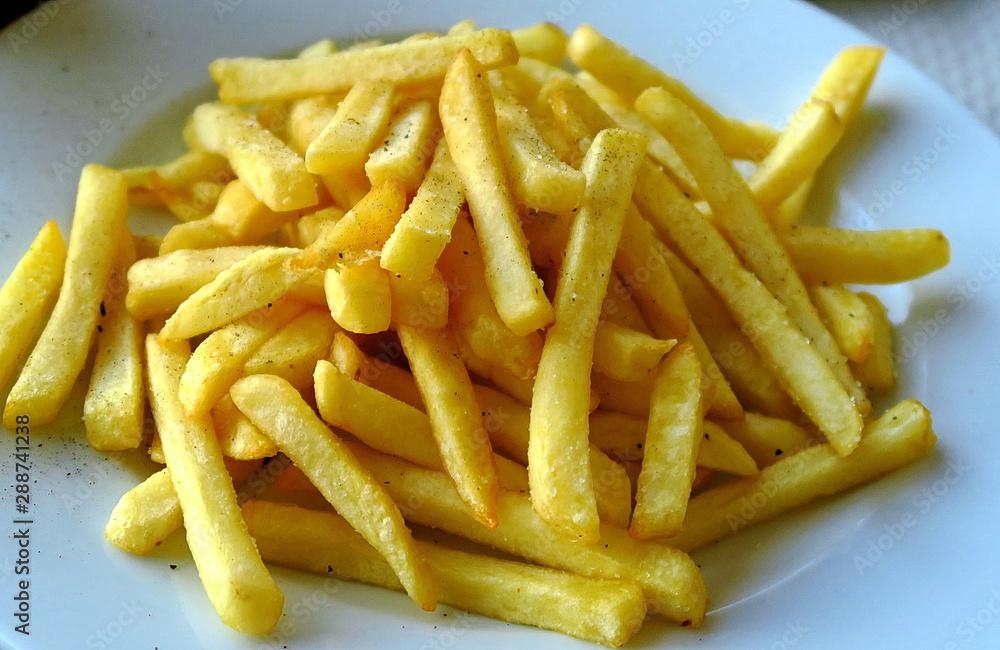 Fototapety, obrazy: Assiette de frites dorées