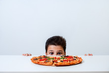The Boy Eats Italian Pizza. Lo...