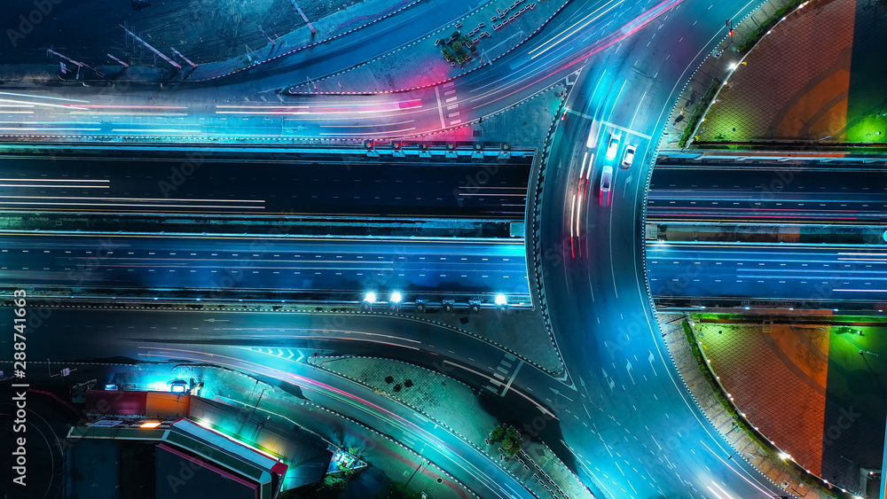 Aerial view Expressway motorway highway circus intersection at Night time Top view , Road traffic in city at thailand.