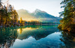 Amazing autumn sunrise of Hintersee lake. Fantastic morning view of Bavarian Alps on the Austrian border, Germany, Europe. Beauty of nature concept background. Orton Effect.