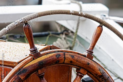 Steering wheel on sailing ship, vintage © AGM