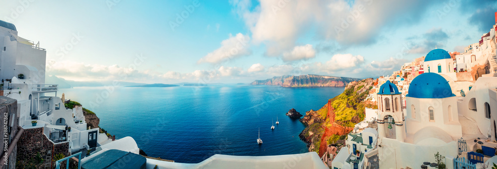 Fototapeta Sunny morning panorama of Santorini island. Colorful spring view offamous Greek resort Fira, Greece, Europe. Traveling concept background. Artistic style post processed photo.
