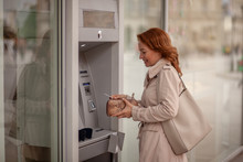 One Mature Woman, Using ATM Ma...