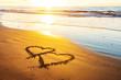 Leinwandbild Motiv Couple hearts on sea beach. Valentine day and love concept