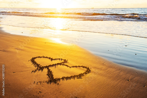 Foto op Aluminium Honing Couple hearts on sea beach. Valentine day and love concept