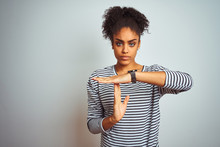 African American Woman Wearing Navy Striped T-shirt Standing Over Isolated White Background Doing Time Out Gesture With Hands, Frustrated And Serious Face