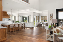 Living Room, Kitchen, And Eating Nook In New Luxury Home With Open Concept Floor Plan