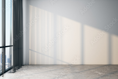 Modern light empty room with blank white wall, concrete floor and big window with city view.