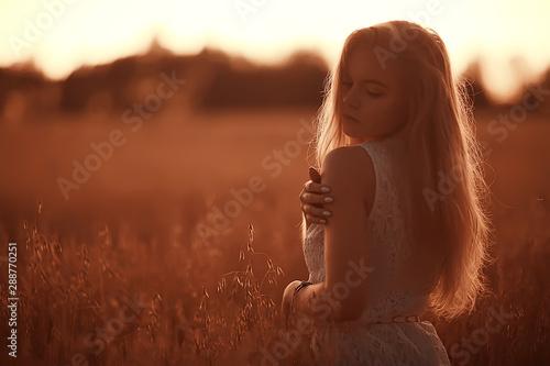 Foto auf AluDibond Dunkelbraun beautiful model posing outdoor nature / adult girl model outdoor nature, happy woman in a summer landscape field