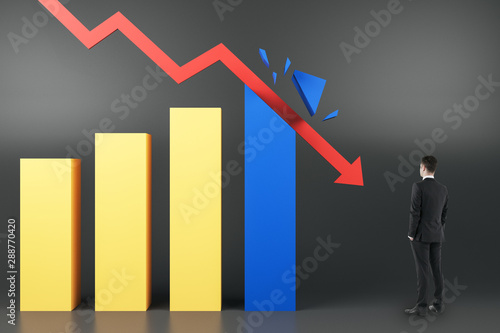 Crisis concept with businessman looking at red arrow breaking business graphs Wallpaper Mural