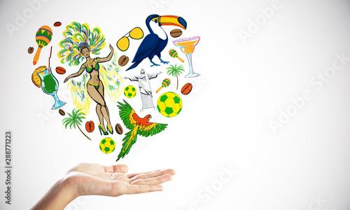 Photo sur Aluminium Amérique du Sud Travel concept with traditional symbols of Brazil heart shaped above human palm.