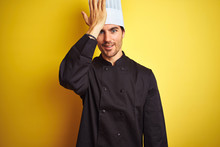 Young Chef Man Wearing Uniform And Hat Standing Over Isolated Yellow Background Surprised With Hand On Head For Mistake, Remember Error. Forgot, Bad Memory Concept.