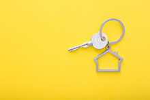 House Keys With Trinket On Color Background, Top View With Copy Space.