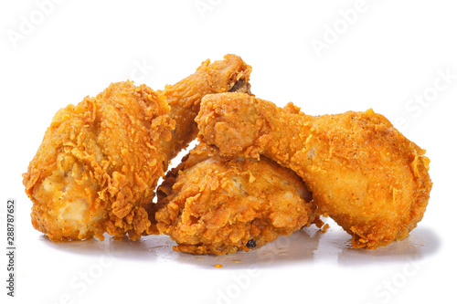 Photo  Fried yellow crispy spicy chicken legs on white background