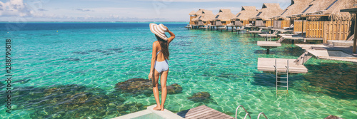 Fotomural Travel luxury resort panoramic banner woman tourist enjoying view from overwater bungalow hotel in Maldives panorama