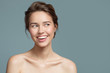 Leinwandbild Motiv Portrait of smiling beautiful woman. Perfect skin. Blue background.