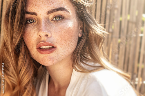 Portrait of young redhead woman with freckles. Poster Mural XXL