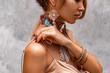 Leinwandbild Motiv close up of beautiful young woman with lots of boho accessories