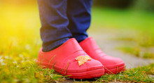 Close Up Photo Of Woman Legs In Rubber Shoes