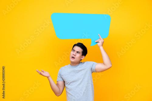 Cuadros en Lienzo Curious Asian man with empty speech bubble