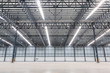 Empty warehouse. Factory building or warehouse building with concrete floor for industry.