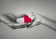 Mother Giving Child Heart. Giv...
