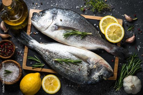 Fototapeta  Raw dorado fish on black
