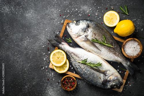 Fotografie, Obraz  Raw dorado fish on black background.