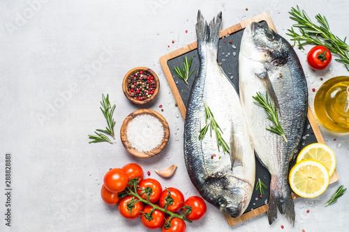 Fototapeta  Fresh fish dorado on blue background.