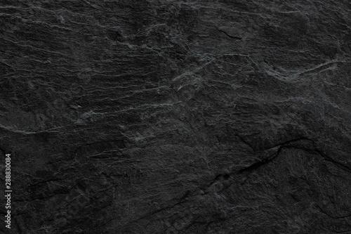 Dark grey black slate background or texture. black stone